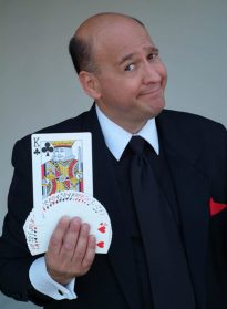 cropped-Kerry-Ross-in-Tux-with-Magic-Cards.jpg